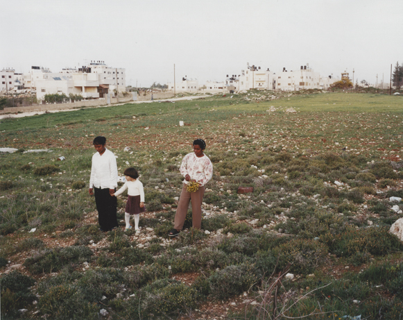 Maids with a Palestinian child, East Jerusalem 2001
